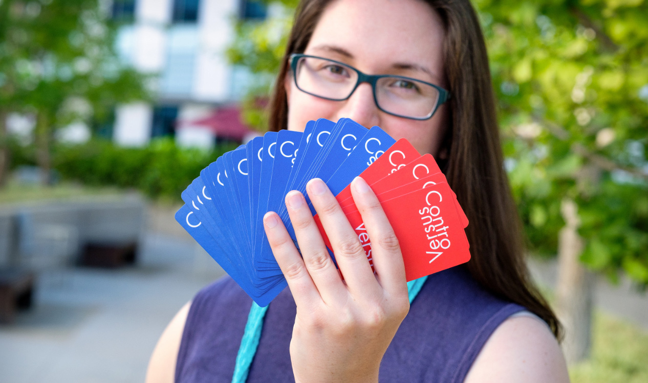 Claire O'Hanlon holding hand of cards.