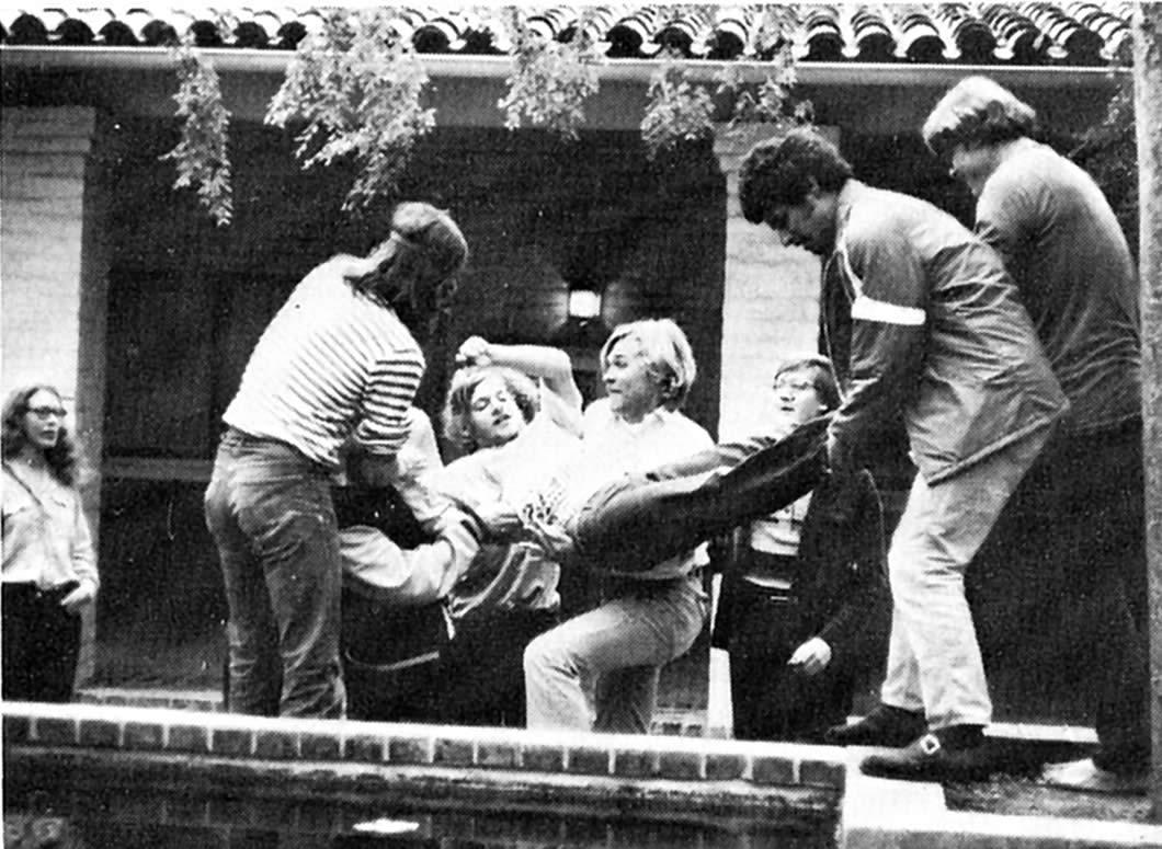 Beverly Orth '74, left, observes classmates tossing Dan Kalman '74 into the Seal Pond, May 1973. Her future husband, Tony Noe '74, is fourth from the right.