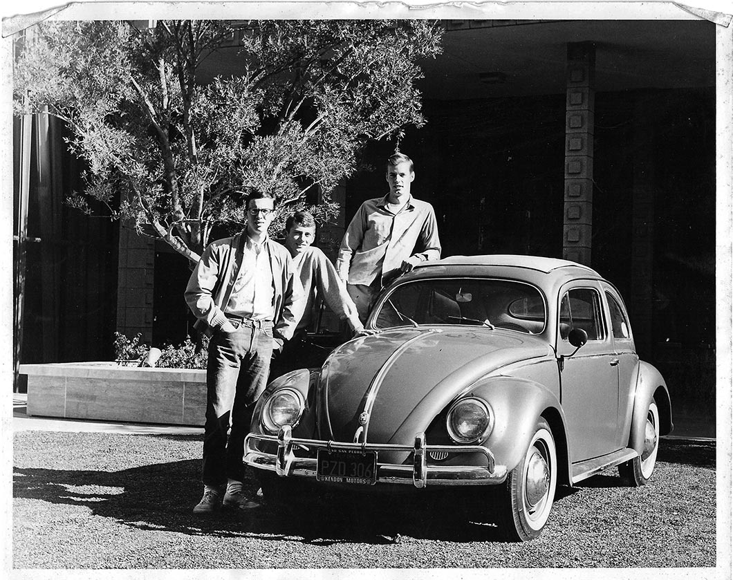 Dennis Rich '66, Gary Jahns '66 and Wolfgang Pflaum '66 pose with VW Beetle.