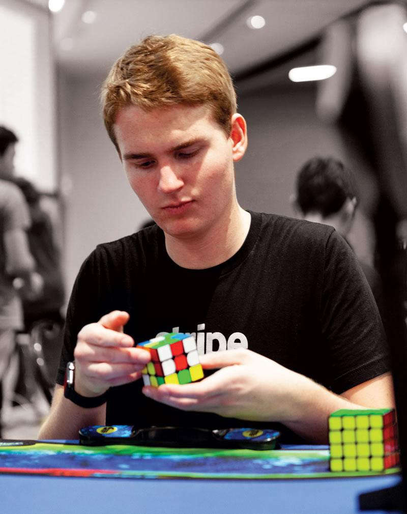 Adam Walker solves a Rubik cube.