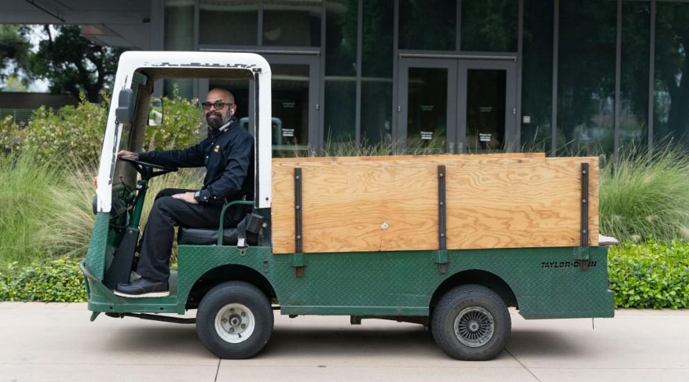 Travis Paddock in maintenance cart
