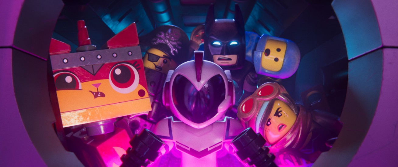 Still from The Lego Movie 2: The Second Part. Assorted characters looking out of a portal.