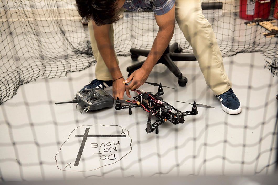 Students works on drone.