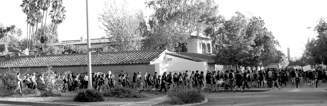 Students march on to Scripps campus.