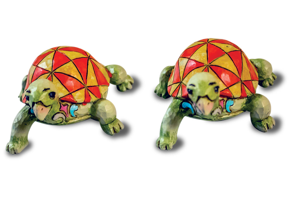 Two colorful turtle models.
