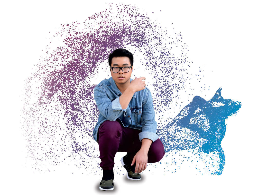Lam Huynh squatting with abstract background.