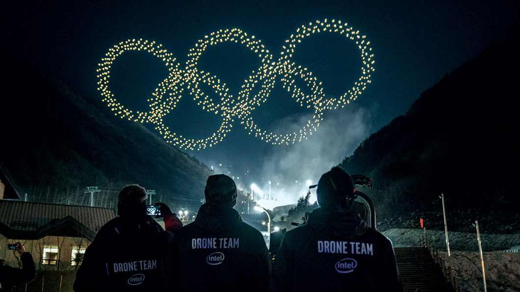 Drones form shape of the Olympic rings in the night sky.